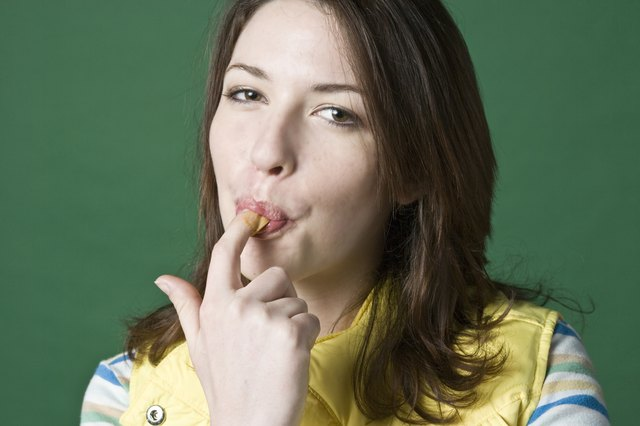Woman licking fingers