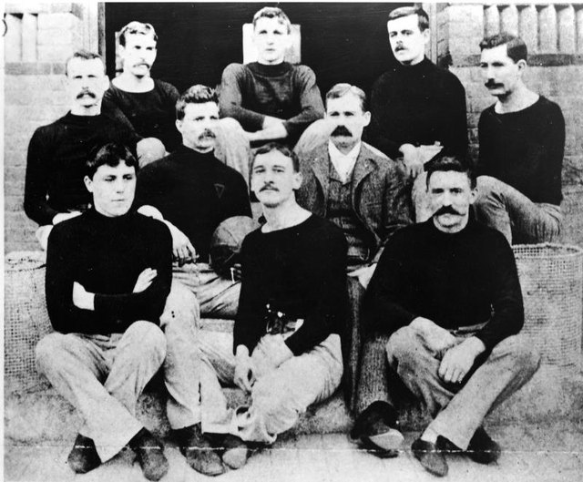 Canadian physician and teacher Dr. James Naismith (1861 - 1939), inventor of the game of basketball, with his first basketball team, Springfield, Mass., 1891