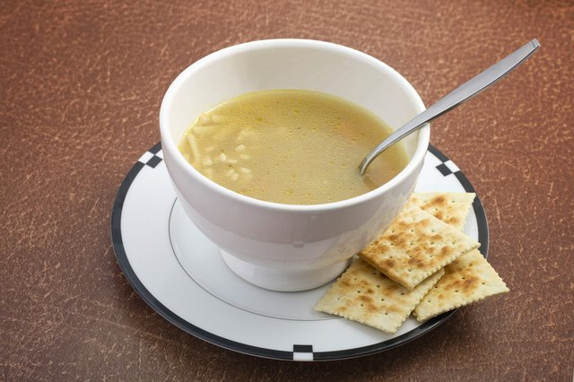 Initially, eat bland foods like crackers and broth.