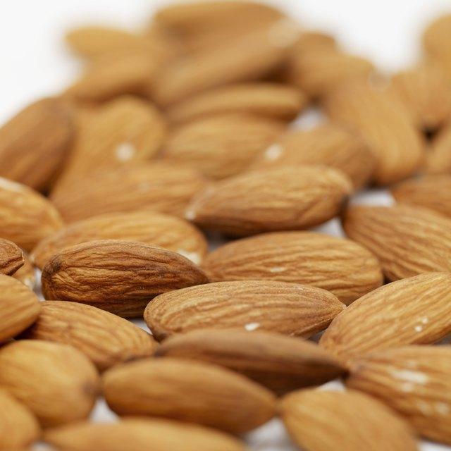 A close up of raw almonds.