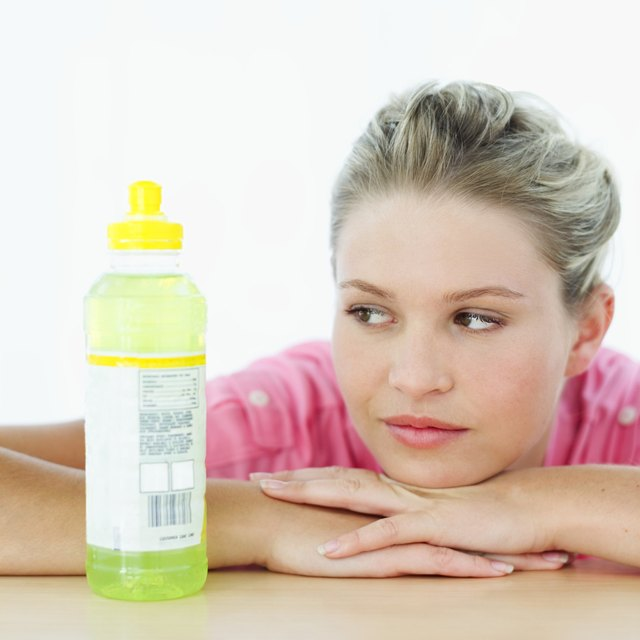 Woman looking at energy drink