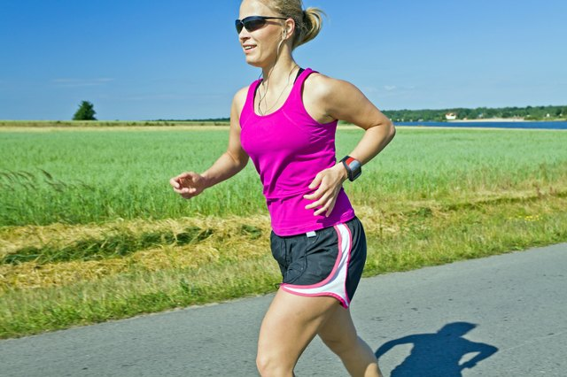 woman jogging along road