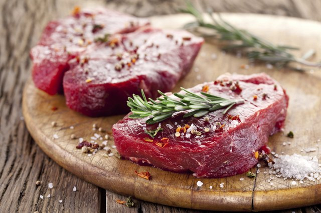 Uncooked steak with herbs and spices
