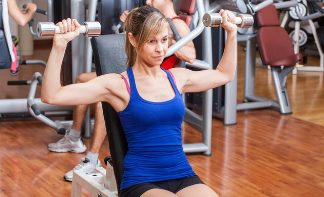 Woman working out at fitness club