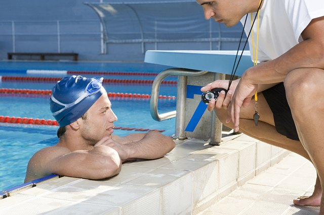 Coaches help swimmers study every aspect of their stroke.