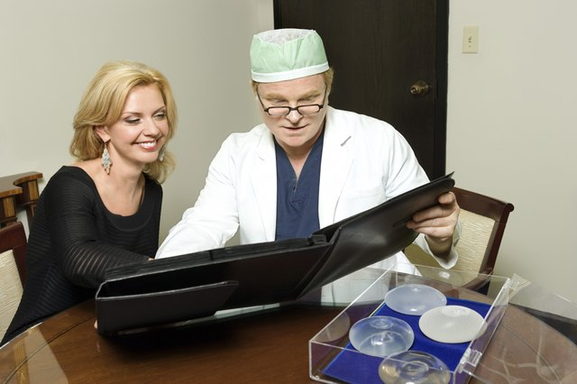 A woman looks over options with a doctor.