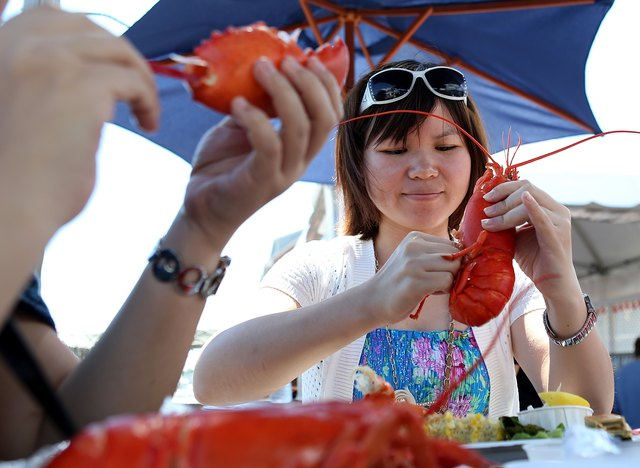 Tourists enjoying lobster in Portland, Maine