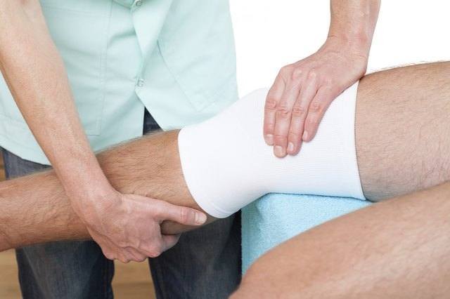 Doctor working on a wrapped knee