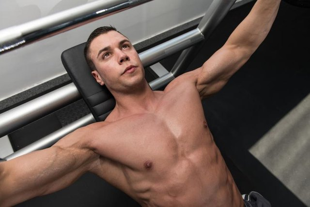 A wide grip changes the emphasis of the bench press.
