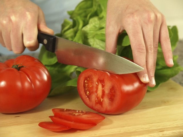 woman slicing tomatoes
