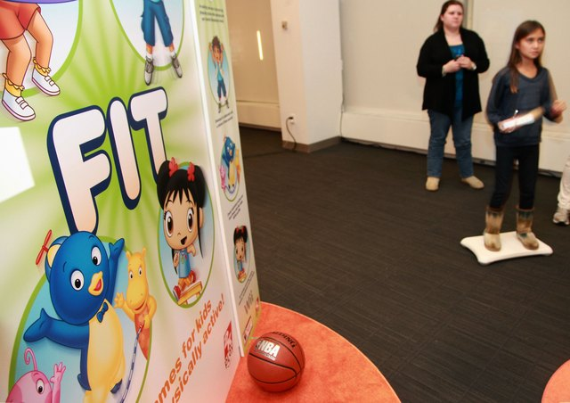 A girl plays a Wii Fit Nickelodean game at a demonstration.