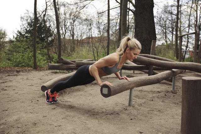A strong incline push-up features a long, straight body.
