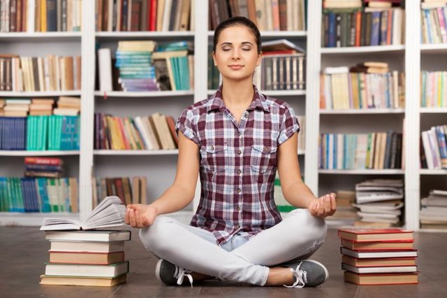 One or more books provide support for a yoga block.