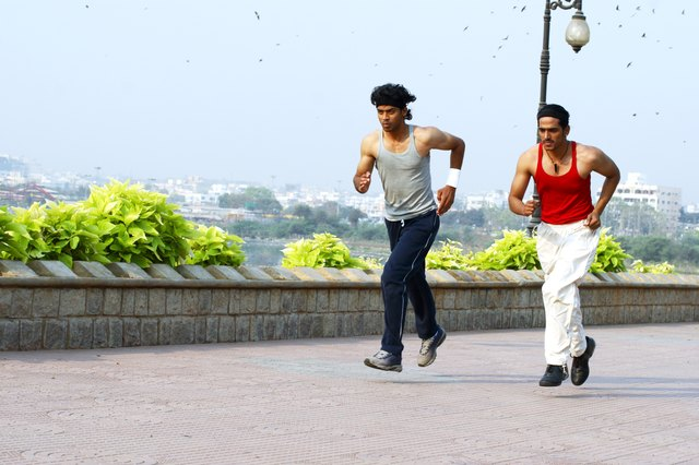 Two men jogging outdoors.