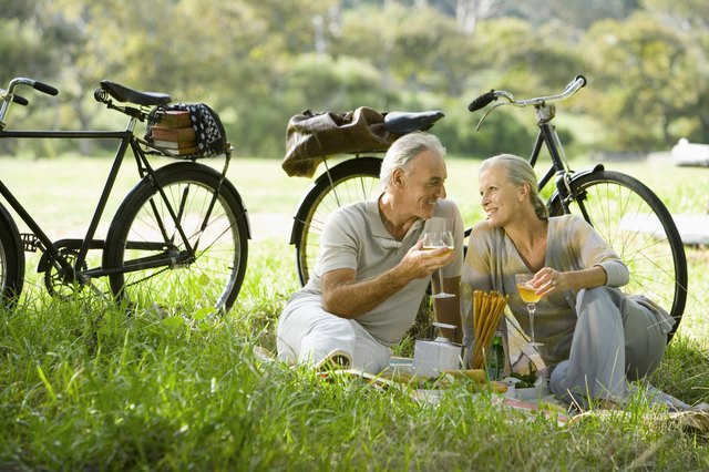 Mature couple eating outdoors.