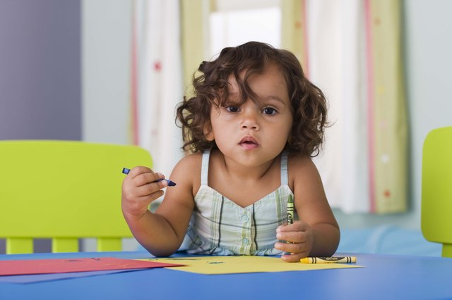 Most 20-month-old toddlers can scribble with a crayon and enjoy creating on a sheet of paper.