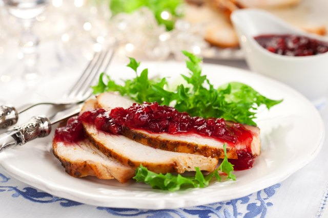 sliced turkey with cranberry