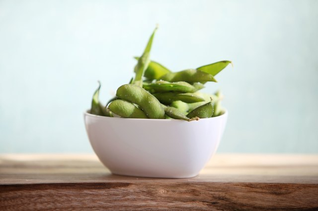 Edamame soy beans in a bowl. Moderation is important for people who choose to consume soy.