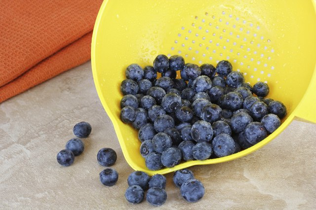 fresh blueberres in strainer