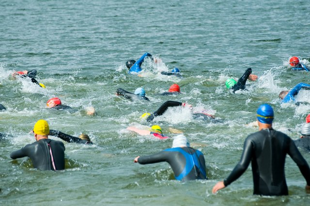 triathlon swimmers going into Ocean