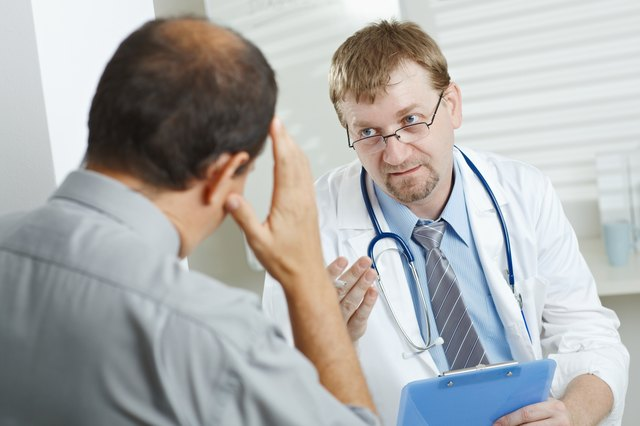 Doctor consulting with man in office