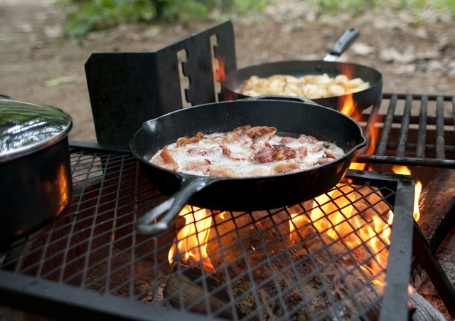 Cooking bacon in pan on grill