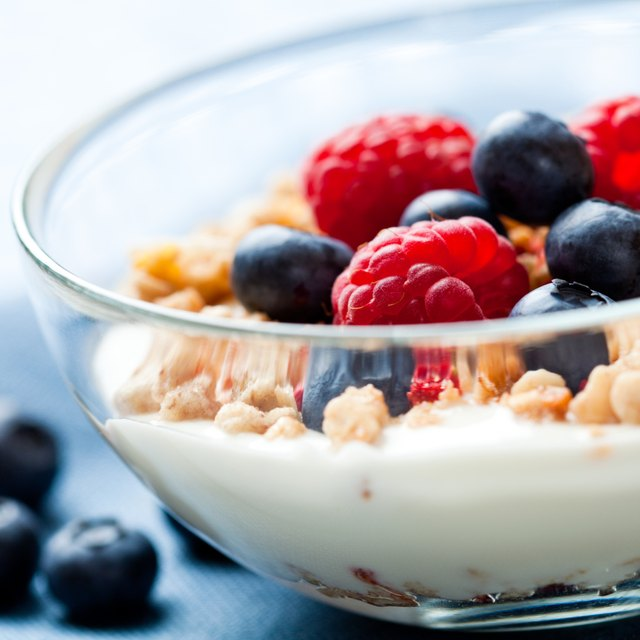 A bowl of yogurt with fruit and granola.