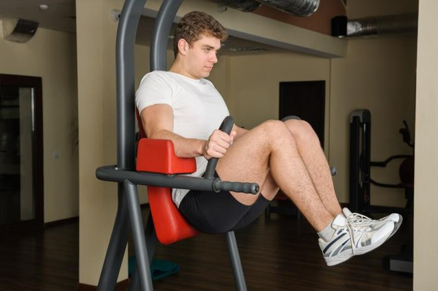 Bend your knees during the captain's chair to ease discomfort in your low back.