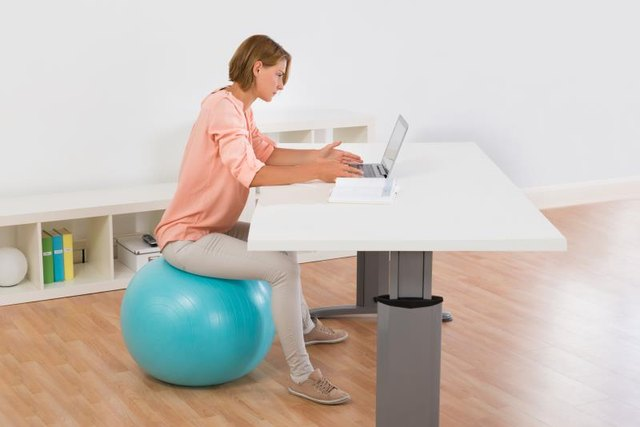 Sit on a stability ball to engage your core all day.