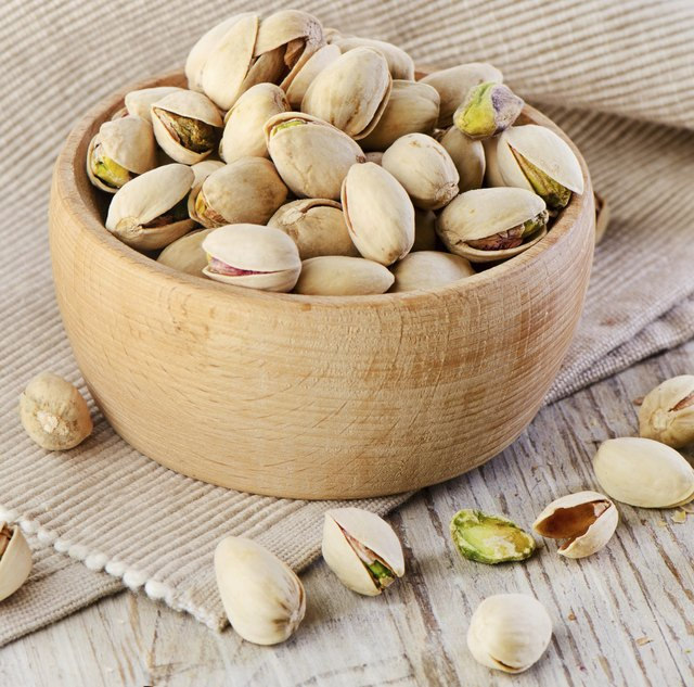 One quarter cup of pistachios contains 14 grams of fat.
