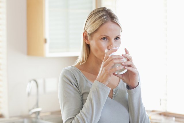 woman drinking glass f water