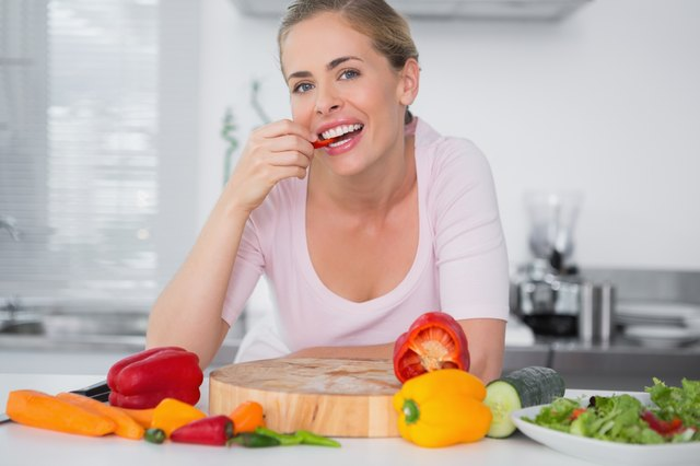 woman slicing red peppers