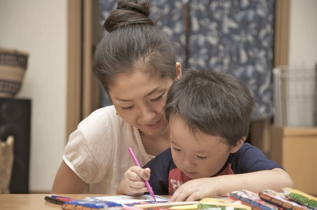 Mother coloring with her son