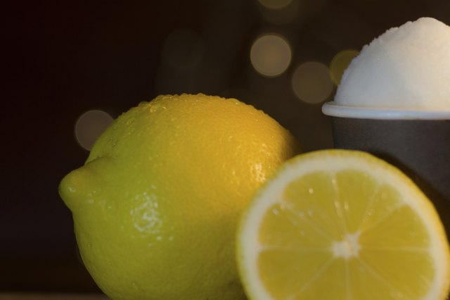 Lemons and a cup of lemon sorbet