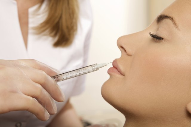 A woman receiving a Botox injection.