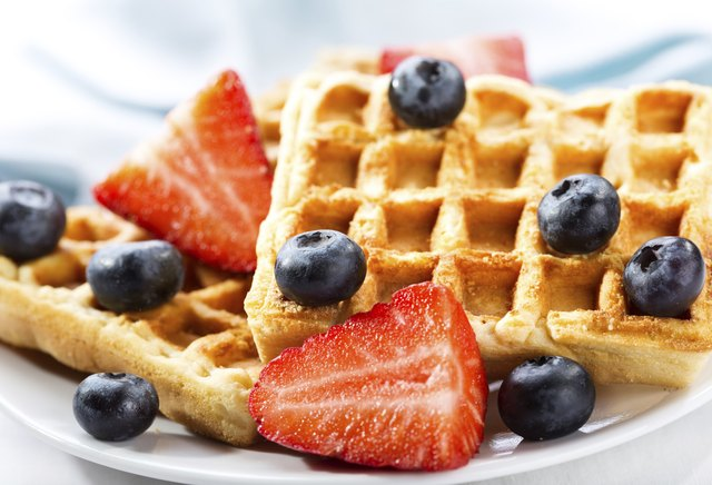 waffles with strawberries and blueberries on top