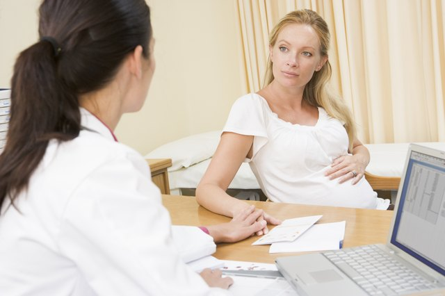 A pregnant woman consulting with her doctor