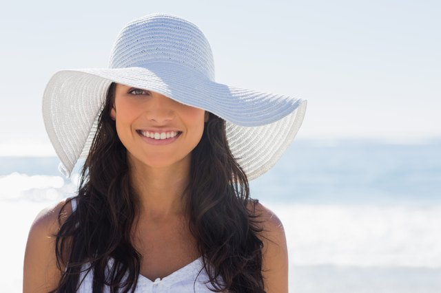 Wear a hat in the hot sun to protect your hair.