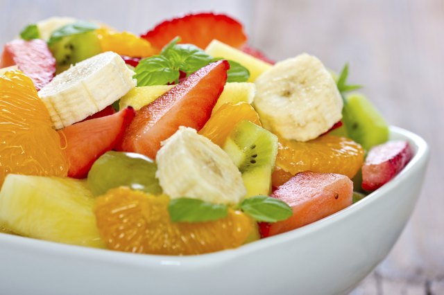 A close up of bowl of fruit salad