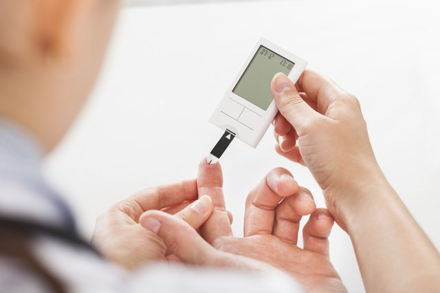 Close-up of a doctor testing a diabetes patient's blood.