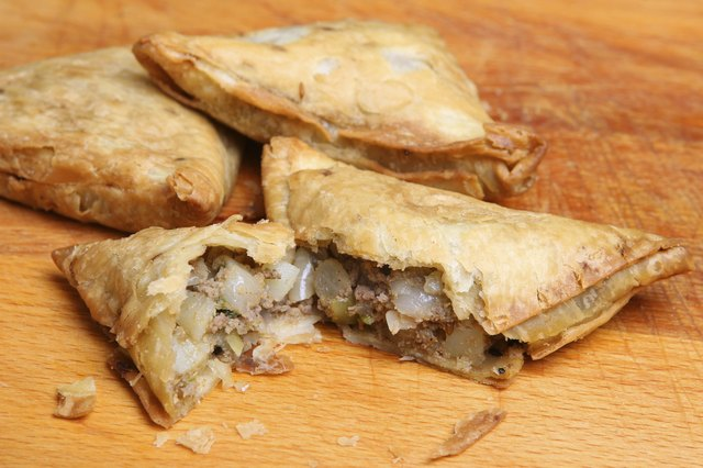 Samosa filled with spicy lamb and vegetable mixture