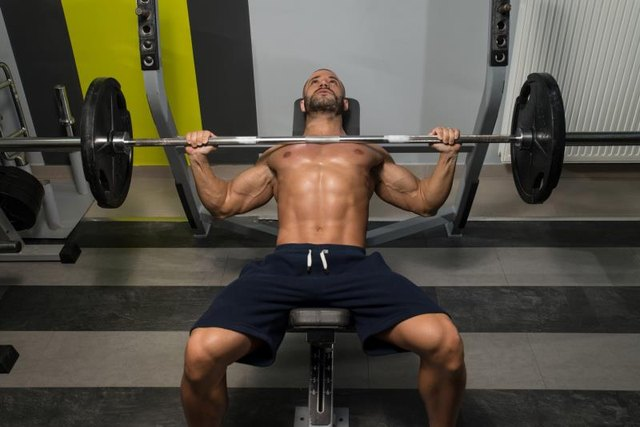 Most Gyms Stock Standard Bars On Bench Racks