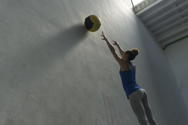 Wall ball exercises can be easily progressed by using a heavier ball.