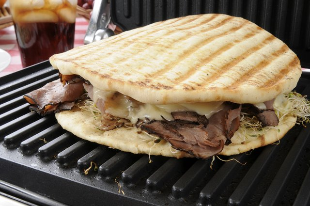 A roast beef sandwich on a panini press.
