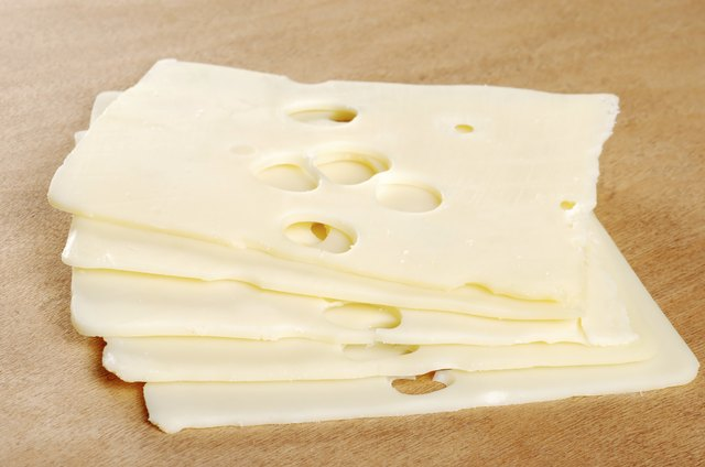 Swiss cheese on cutting board