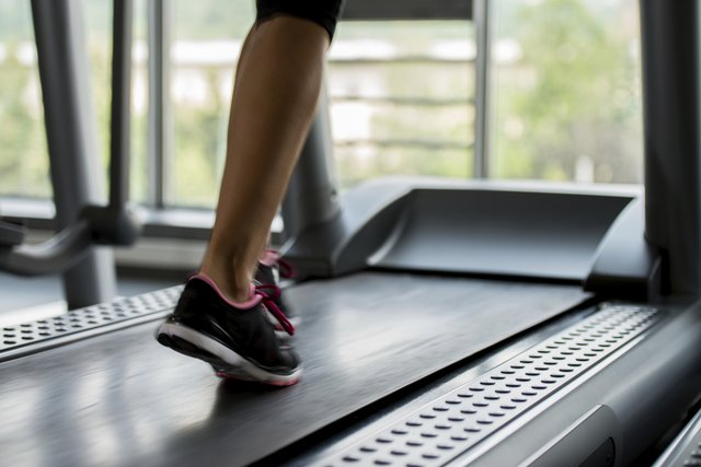 Close-up of legs walking on a treadmill