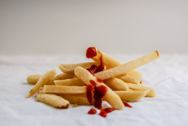 McDonald's french fries get dunked in an oil bath twice. The manufacturers cut and boil them and fry them once before freezing them and shipping them to restaurants, where they are fried again.