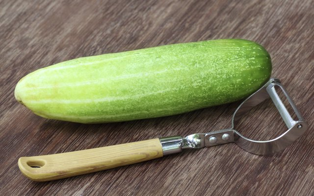 cucumber next to peeler