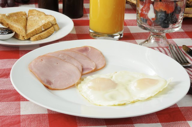 Poached eggs with Canadian bacon.