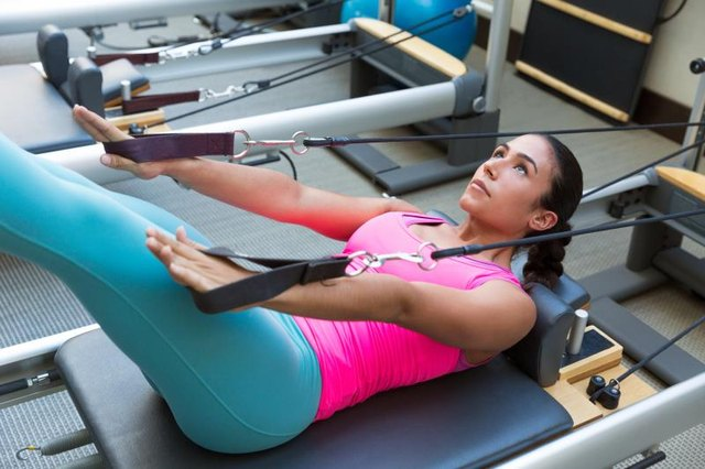 Core workouts on the reformer include the hundred.